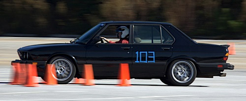Andy's wife, Allison, autocrossing his 1988 BMW M5.
